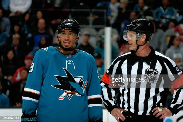 Evander Kane of the San Jose Sharks and Referee Dan O'Rourke chat during a NHL game against the Washington Capitols at SAP Center on March 10 2018 in...