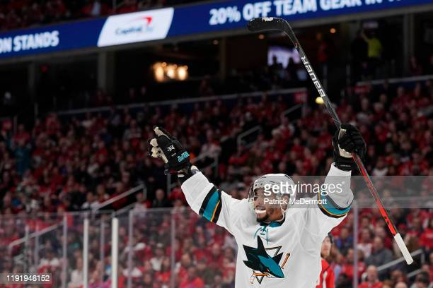 Evander Kane of the San Jose Sharks celebrates after scoring his third goal of the game for a hat trick in the second period against the Washington...