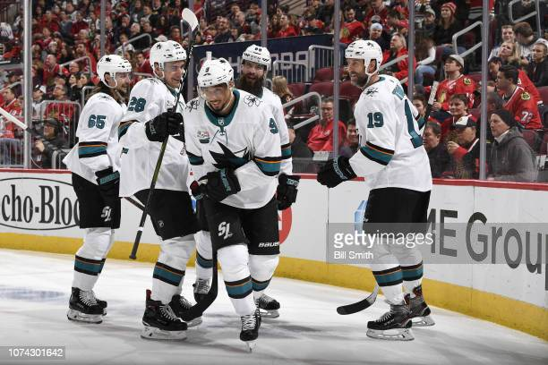 Evander Kane of the San Jose Sharks celebrates with teammates after scoring against the Chicago Blackhawks in the second period at the United Center...