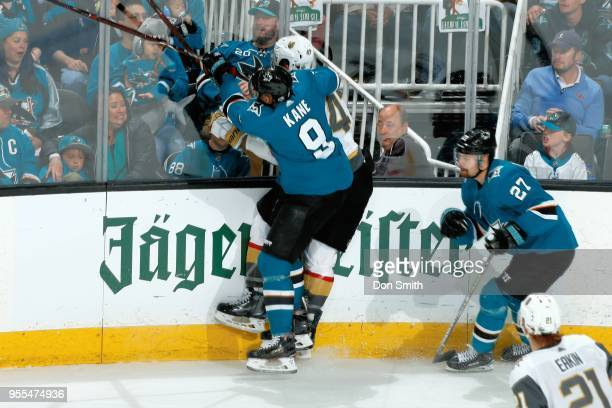 Evander Kane of the San Jose Sharks checks Luca Sbisa of the Vegas Golden Knights in Game Six of the Western Conference Second Round during the 2018...