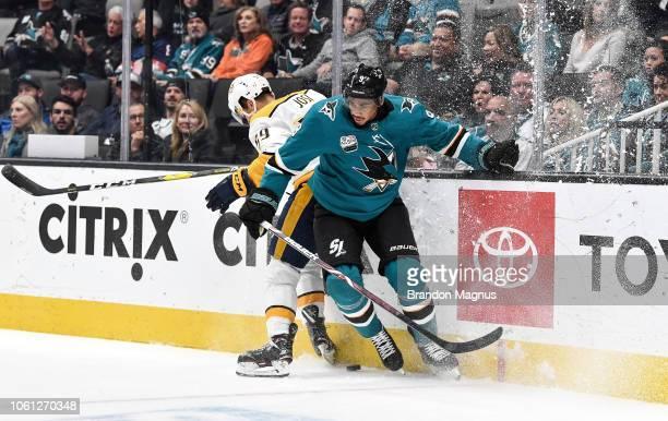 Evander Kane of the San Jose Sharks collides with Roman Josi of the Nashville Predators at SAP Center on November 13 2018 in San Jose California