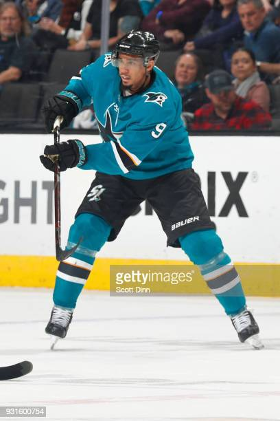 Evander Kane of the San Jose Sharks passes the puck during a NHL game against the Detroit Red Wings at SAP Center on March 12 2018 in San Jose...