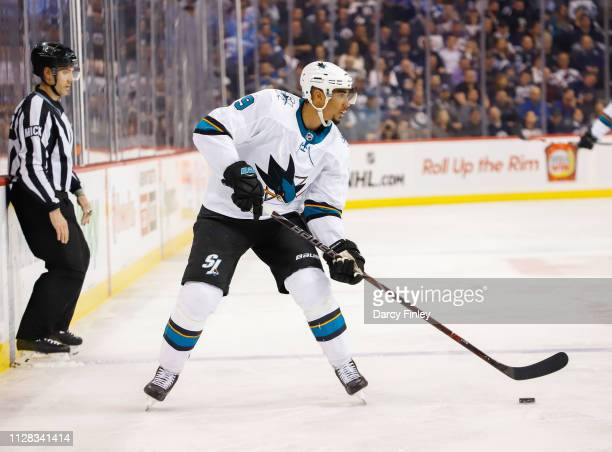Evander Kane of the San Jose Sharks plays the puck down the ice during third period action against the Winnipeg Jets at the Bell MTS Place on...