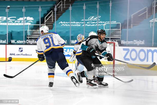 Evander Kane of the San Jose Sharks reacts after colliding with Vladimir Tarasenko of the St. Louis Blues at SAP Center on March 19, 2021 in San...