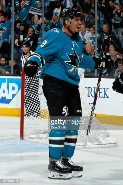 Evander Kane of the San Jose Sharks reacts after scoring a goal against the Calgary Flames at SAP Center on March 24 2018 in San Jose California