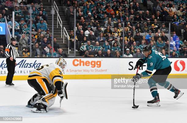 Evander Kane of the San Jose Sharks shoots the puck against Tristan Jarry of the Pittsburgh Penguins at SAP Center on February 29 2020 in San Jose...