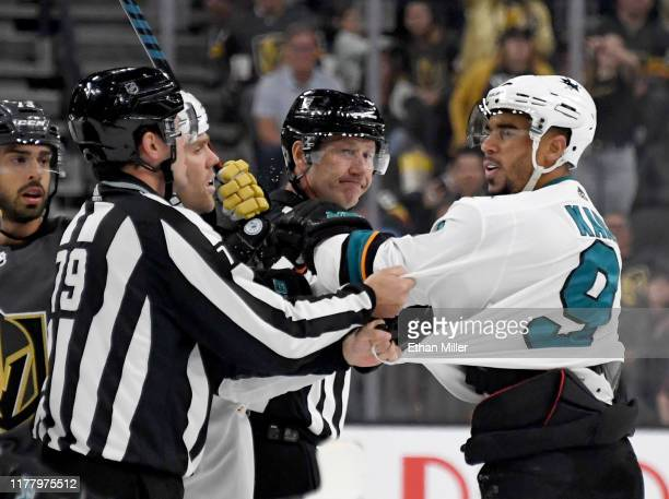 Evander Kane of the San Jose Sharks shoves linesman Kiel Murchison in the third period of the Sharks' preseason game against the Vegas Golden Knights...