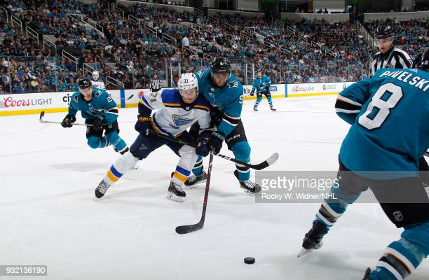 Evander Kane of the San Jose Sharks skates after the puck against Vladimir Sobotka of the St Louis Blues at SAP Center on March 8 2018 in San Jose...