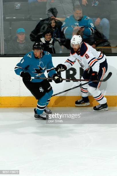 Evander Kane of the San Jose Sharks skates against Adam Larsson of the Edmonton Oilers at SAP Center on February 27 2018 in San Jose California