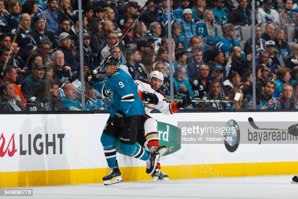 Evander Kane of the San Jose Sharks skates against Francois Beauchemin of the Anaheim Ducks in Game Three of the Western Conference First Round...