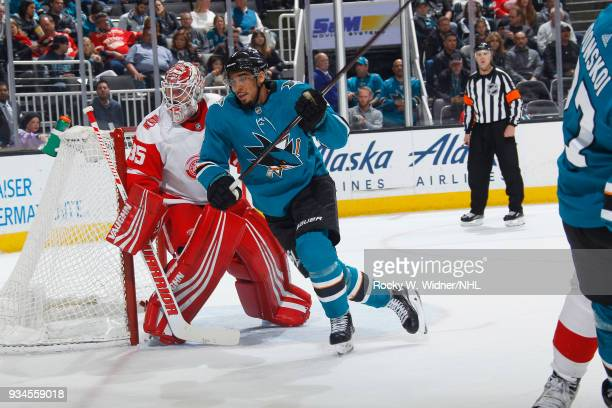 Evander Kane of the San Jose Sharks skates against Jimmy Howard of the Detroit Red Wings at SAP Center on March 12 2018 in San Jose California