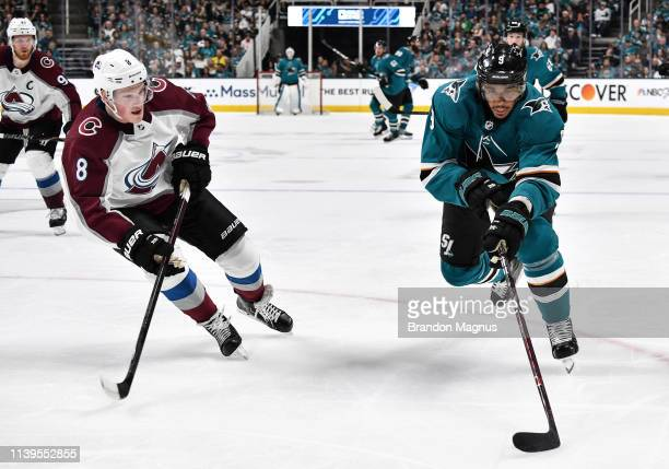 Evander Kane of the San Jose Sharks skates ahead with the puck against Cale Makar of the Colorado Avalanche in Game One of the Western Conference...