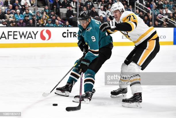 Evander Kane of the San Jose Sharks skates ahead with the puck against Evgeni Malkin of the Pittsburgh Penguins at SAP Center on January 15 2018 in...
