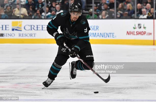 Evander Kane of the San Jose Sharks skates the puck ahead against the Dallas Stars at SAP Center on December 13 2018 in San Jose California