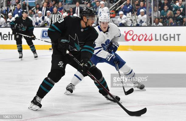 Evander Kane of the San Jose Sharks skates with the puck against Mitchell Marner of the Toronto Maple Leafs at SAP Center on November 15 2018 in San...