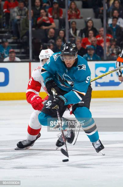 Evander Kane of the San Jose Sharks skates with the puck against the Detroit Red Wings at SAP Center on March 12 2018 in San Jose California