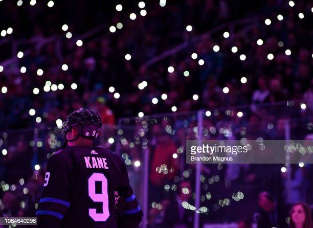Evander Kane of the San Jose Sharks stands for a moment of silence before the game against the Vancouver Canucks at SAP Center on November 23 2018 in...