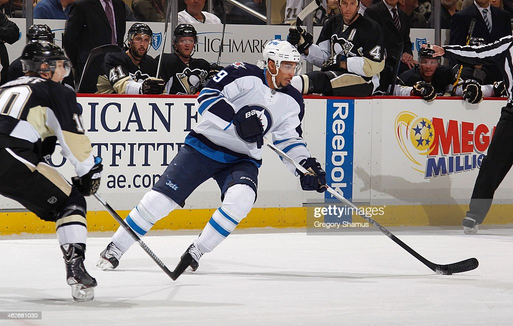 Evander Kane #9 of the Winnipeg Jets moves the puck in front of Christian Ehrhoff #10 of the Pittsburgh Penguins at Consol Energy Center on January 27, 2015 in Pittsburgh, Pennsylvania.