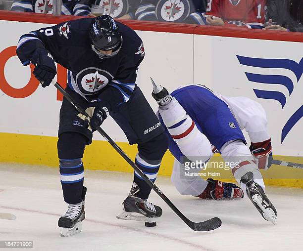 Evander Kane of the Winnipeg Jets trips up Brandon Prust of the Montreal Canadiens in third period action of an NHL game at the MTS Centre on October...