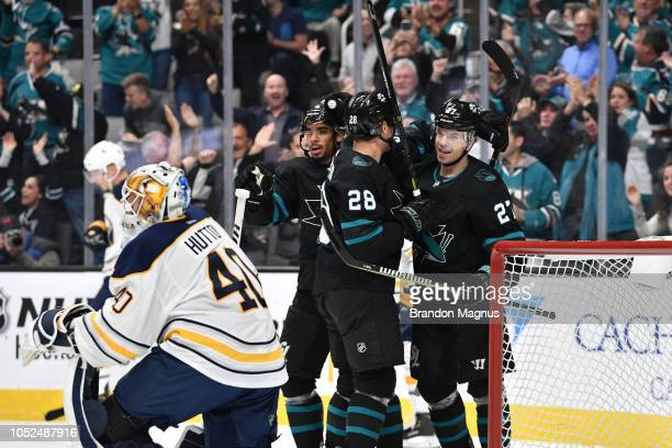 Evander Kane Timo Meier and Joonas Donskoi of the San Jose Sharks celebrate a goal against the Buffalo Sabres at SAP Center on October 18 2018 in San...