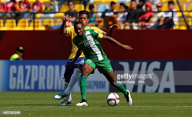 Evander of Brazil and Kelechi Nwakali of Nigeria battle for the ball during the FIFA U17 Men's World Cup 2015 quarter final match between Brazil and...