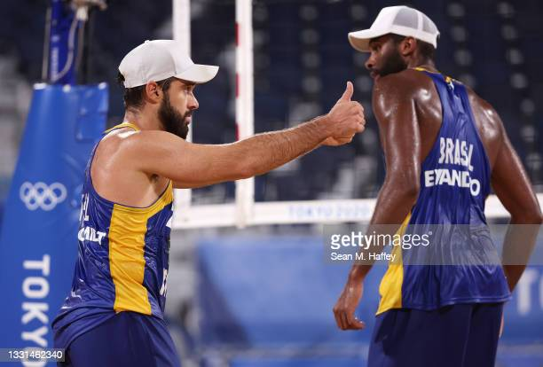 Evandro Goncalves Oliveira Junior and Bruno Oscar Schmidt of Team Brazil react after defeating Team Poland during the Men's Preliminary - Pool E...