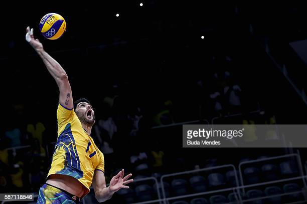 Evandro Guerra spikes the ball during the men's qualifying volleyball match between Brazil and Mexico on August 7 2016 in Rio de Janeiro Brazil