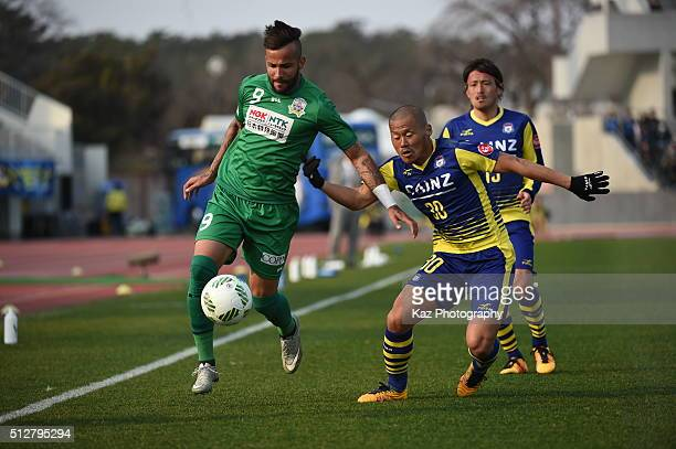 Evandro of FC Gifu beats Yuki Matsushita of Thespa Kusatsu Gunma during the JLeague second division match between Thespa Kusatsu Gunma and FC Gifu at...