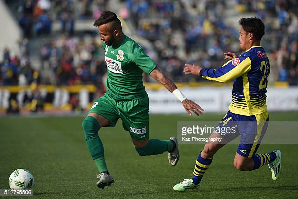 Evandro of FC Gifu dribbles the ball under the pressure from Yuko Takase of Thespa Kusatsu Gunma during the JLeague second division match between...