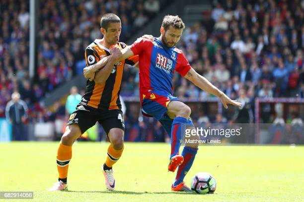 Evandro of Hull City and Yohan Cabaye of Crystal Palace battle for possession during the Premier League match between Crystal Palace and Hull City at...
