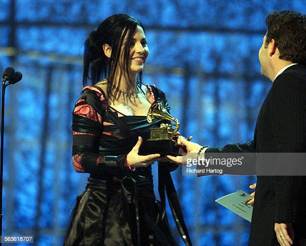 AWARDS –– Evanescence singer Amy Lee accepts their award for best new artist during the 46th Annual Grammy Awards show at the Staples Center in Los...