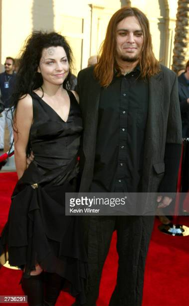 Evanescence Singer Amy Lee and boyfriend Shaun Morgan attends the 31st Annual American Music Awards at The Shrine Auditorium November 16 2003 in Los...