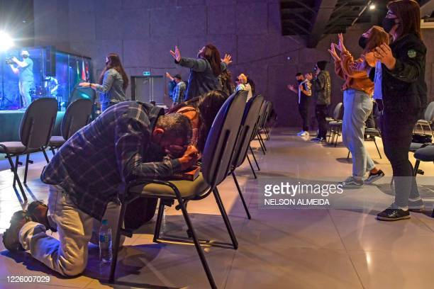 """Evangelical faithful attend a cult at the """"Edificando em Cristo"""" church in Sao Paulo, Brazil, on July 8, 2020. - With studio lights, several video..."""