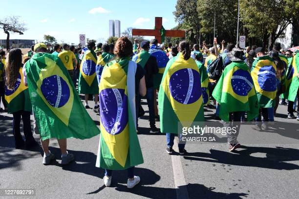 Evangelical groups take part in a demonstration in support of Brazilian President Jair Bolsonaro's government in front of the Congress in Brasilia,...