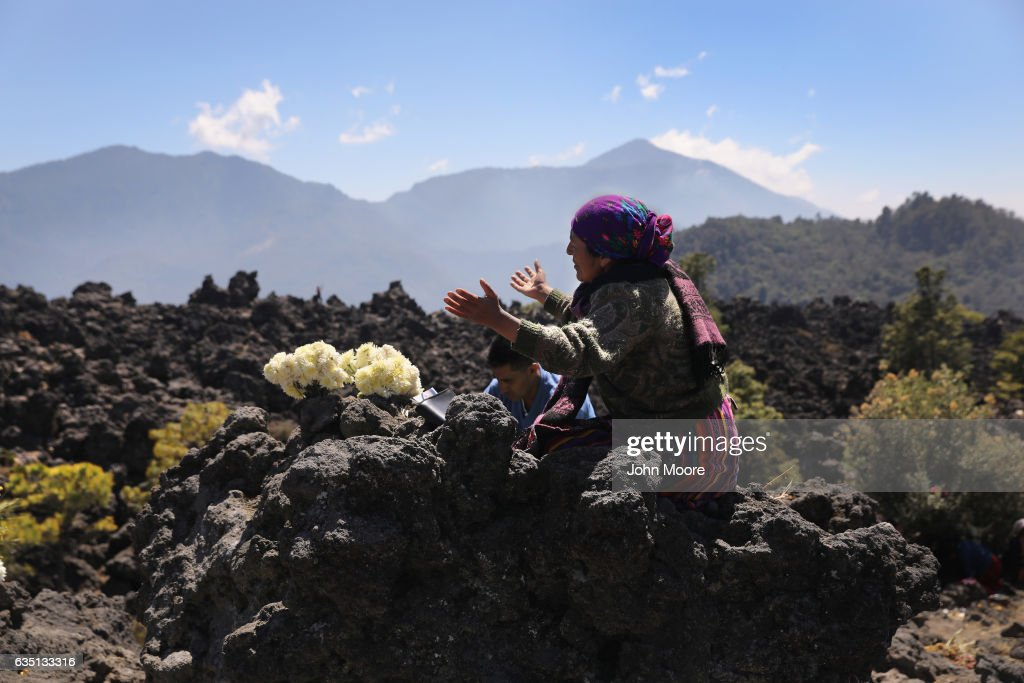 Evangelical Mayans pray from atop Cerro Quemado, a sacred Mayan site February 12, 2017 in Almolonga, Guatemala. Almolonga, a Mayan town in the western highlands district of Quetzaltenango has surged in prosperity in recent years with high-productivity farming, exporting much of its excess crops to neighborning El Salvador. Almolonga has been called the 'Vegetable Basket of the Americas.' Many locals attribute the town's change in fortunes to the rapid growth of the Evangelical Christian faith in the area, while others credit the increased use of pesticide farming. Regardless, the strong local economy will be key maintaining the town's prosperity if the Trump Administration follows through on a pledge to curtail remittance money sent back from undocumented immigrants in the U.S. to their families in Guatemala.