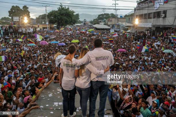 Evangelical pastor Javier Bertucci presidential candidate for the Esperanza Por El Cambio Party right stands with his children during his closing...
