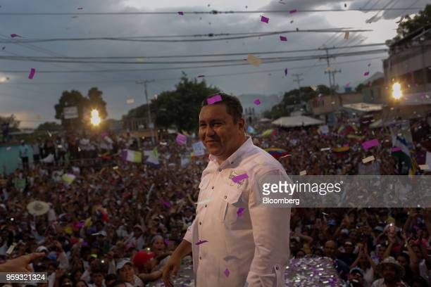 Evangelical pastor Javier Bertucci presidential candidate for the Esperanza Por El Cambio Party reacts after speaking during his closing campaign...