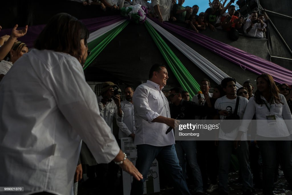 Evangelical pastor Javier Bertucci, presidential candidate for the Esperanza Por El Cambio (EEC) Party, center, arrives to speak during his closing campaign rally in Valencia, Carabobo state, on Wednesday, May 16, 2018. Venezuelans head to the polls on May 20, as foreign leaders call for a suspension and the country's main opposition alliance shun the elections. Photographer: Manaure Quintero/Bloomberg via Getty Images