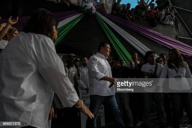 Evangelical pastor Javier Bertucci presidential candidate for the Esperanza Por El Cambio Party center arrives to speak during his closing campaign...