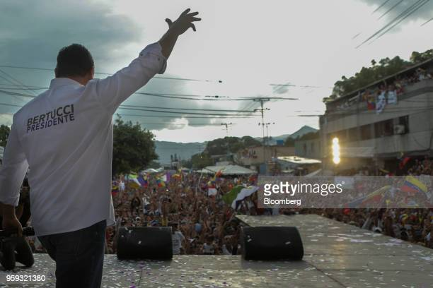 Evangelical pastor Javier Bertucci presidential candidate for the Esperanza Por El Cambio Party waves as he arrives to speak during his closing...