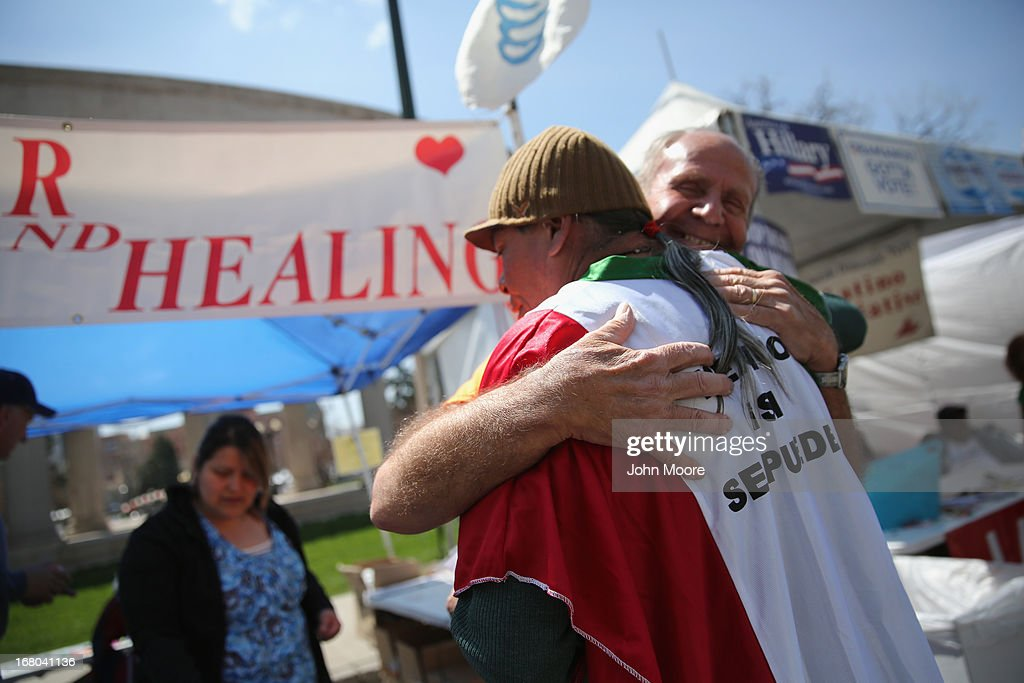 Evangelical pastor Karl Hunt gives a hug at his Prayer and Healing booth at a Cinco de Mayo festival celebrating Mexican culture on May 4, 2013 in Denver, Colorado. Hundreds of thousands of people were expected to attend the two day event, billed as the largest Cinco de Mayo celebration in the United States. Cinco de Mayo observes the victory of the Mexican army over French forces on May 5, 1862 in the town of Puebla, Mexico. The festival celebrates Mexican culture and is one of the most popular annual Latino events in the United States.