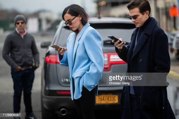 Evangelie Smyrniotaki and Carlo Sestin seen texting with their phone outside Boss during New York Fashion Week Autumn Winter 2019 on February 13 2019...