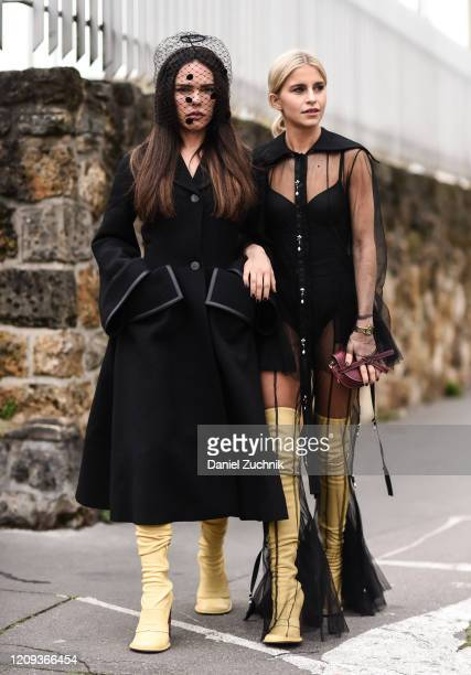 Evangelie Smyrniotaki and Caroline Daur are seen outside the Loewe show during Paris Fashion Week: AW20 on February 28, 2020 in Paris, France.