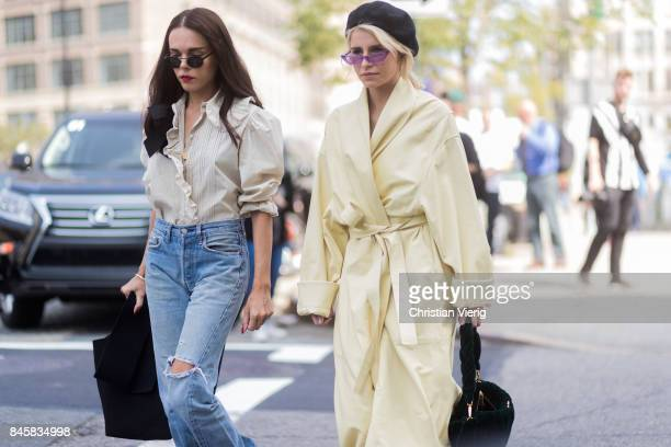 Evangelie Smyrniotaki and Caroline Daur wearing a yellow coat beret seen in the streets of Manhattan outside Zimmermann during New York Fashion Week...