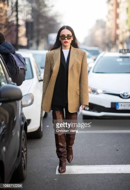 Evangelie Smyrniotaki is seen wearing beige plaid blazer brown overknees boots utside Sunnei during Milan Menswear Fashion Week Autumn/Winter 2019/20...