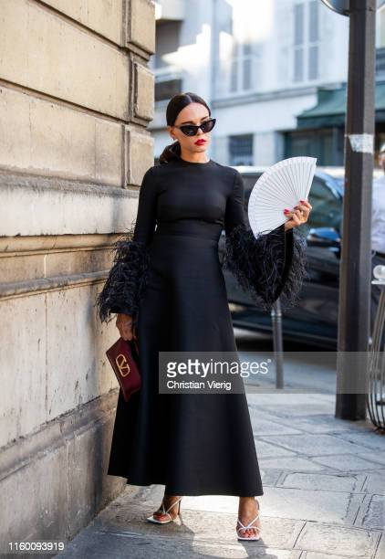Evangelie Smyrniotaki is seen wearing black dress outside Valentino during Paris Fashion Week - Haute Couture Fall/Winter 2019/2020 on July 03, 2019...