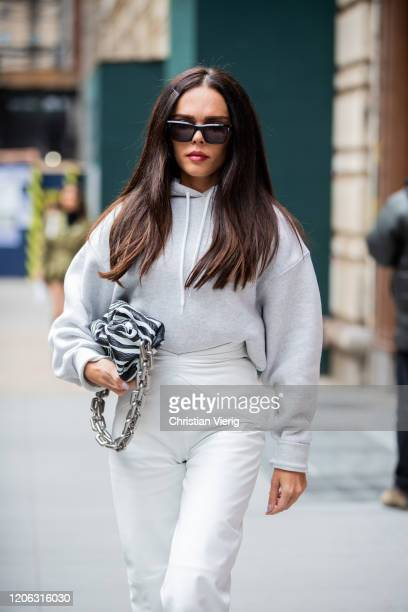 Evangelie Smyrniotaki is seen wearing white hoody and pants bag with zebra print outside Michael Kors during New York Fashion Week Fall / Winter 2020...
