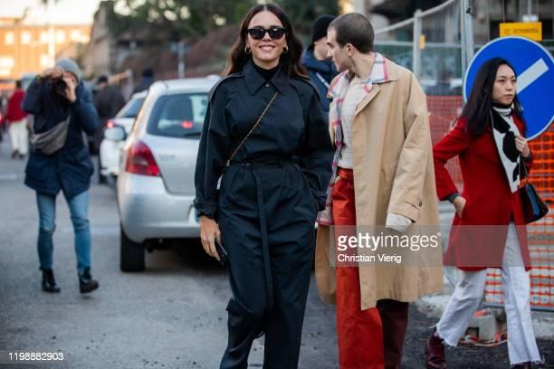 Evangelie Smyrniotaki seen wearing black overall and Carlo Sestini outside Marni during Milan Men Fashion Week Fall Winter 2020/2021 on January 11...