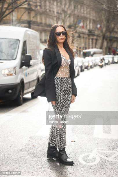 Evangelie Smyrniotaki wearing black blazer, Paco Rabanne dress and Celine sunglasses outside the Paco Rabanne show during the Paris Fashion Week...