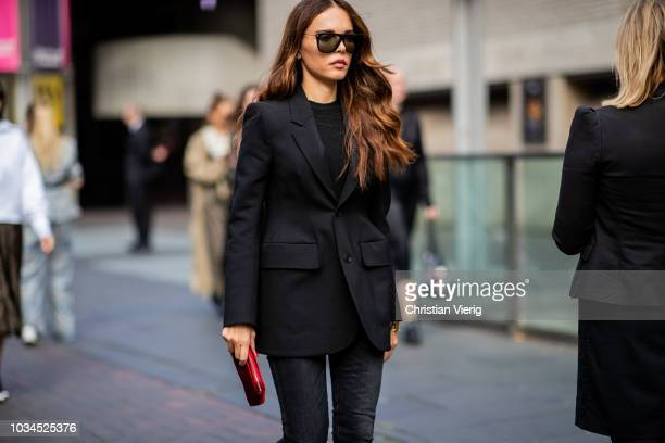 Evangelie Smyrniotaki wearing black cropped denim jeans black blazer ankle boots is seen outside Roland Mouret during London Fashion Week September...